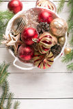 Christmas basket with red and golden ornaments Stock Photos