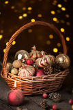 Christmas basket with red and golden ornaments Stock Image