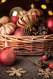 Christmas basket with red and golden ornaments Stock Photography