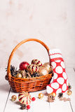 Christmas basket with red and golden ornaments Royalty Free Stock Images