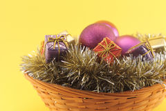 Christmas basket on yellow background Royalty Free Stock Photography