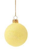 Christmas bauble. Yellow Christmas bauble isolated on white background stock image