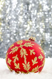 Christmas bauble. Set against a sparkling background Royalty Free Stock Image