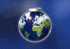 Christmas Bauble. Decoration with snow and planet earth inside Royalty Free Stock Images
