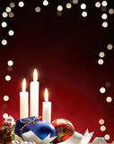 Christmas bauble. And candle light, studio shot Royalty Free Stock Photography
