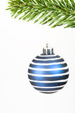 Christmas bauble. A blue and white christmas bauble hanging from a christmas tree Royalty Free Stock Images