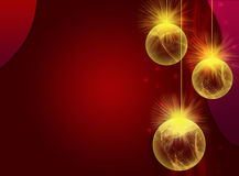 Christmas bauble background. Golden Christmas balls or baubles on decorative red background with copy space Stock Image