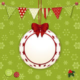 Christmas bauble and background. Christmas background with bauble label, bunting and buttons on green snowflakes Stock Photo