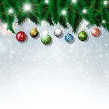 Christmas bauble background. Christmas baubles on a snowflake background Stock Photography