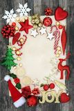 Christmas Bauble Background Border. Christmas background border with joy sign, bauble decorations, mince pies, holly, mistletoe and foil wrapped  chocolates on Royalty Free Stock Images