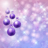Christmas bauble background. Chrsitmas baubles on a snowflake background Stock Photo