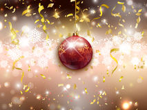 Christmas bauble background. Decorative background for Christmas and the New Year with confetti and streamers Royalty Free Stock Images