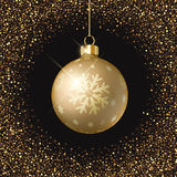 Christmas bauble background. Christmas bauble on a gold glittery background Royalty Free Stock Photos