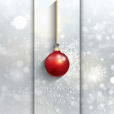 Christmas bauble background. Christmas background with hanging bauble on snowflake design Stock Photos