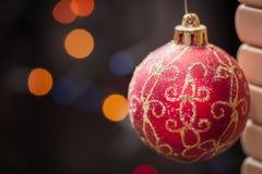 Christmas Bauble. Christmas ball on abstract light background stock photos