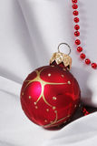 Christmas bauble and beads Royalty Free Stock Photo