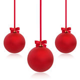 Christmas Bauble Beauty. Christmas baubles in red with ribbons and bows in abstract design, isolated over white background Royalty Free Stock Images