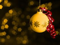 Christmas bauble in blurry back Royalty Free Stock Image