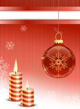 Christmas bauble and candles Stock Images