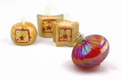 Christmas bauble and candles stock photography