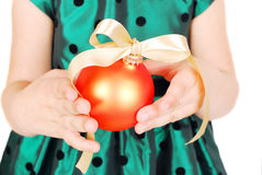 Christmas bauble in child hands. Stock Image