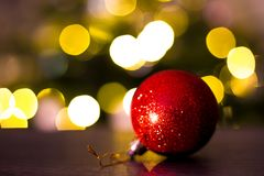 Christmas bauble and lights. Christmas bauble with Christmas lights in background Stock Photos