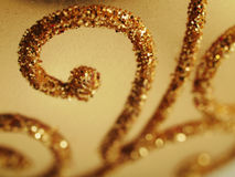 Holiday gold glitter. Christmas bauble close up shallow dof Royalty Free Stock Photos