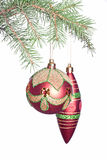 Christmas bauble and cone on fir-tree Stock Photo