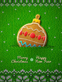 Christmas bauble cookie on knitted background Royalty Free Stock Photo