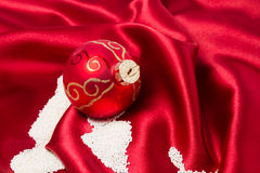 Christmas bauble decorating with sugar as snow. Royalty Free Stock Photo