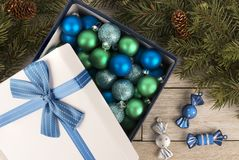 Christmas bauble decoration in a gift box with ribbon and bow. stock photo