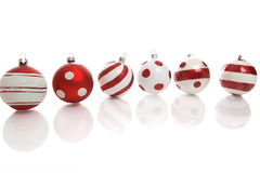 Christmas bauble decorations. Red and white Christmas baubles on a white background with space for copy Stock Photo