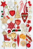 Christmas Bauble Decorations. With gold joy sign, holly, mistletoe, gingerbread biscuits, dried orange fruit and mince pie on rustic white wood background Royalty Free Stock Photography