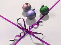 Christmas bauble decorations with ribbon and bow. 3D representation of Christmas bauble decorations with colored ribbon and bow of a gift box, referring to Stock Images