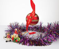 Christmas bauble and decorations with tinsel isolated on white Stock Images