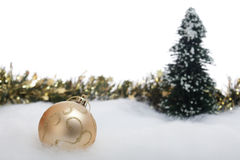 Christmas bauble with fir tree and garland Stock Photo