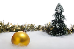 Christmas bauble with fir tree and garland Royalty Free Stock Photography