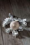 Christmas bauble with fir twig on wooden background Stock Image