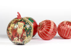 Christmas bauble in front of other red balls. Christmas bauble with a drawing of Santa Claus in front of others red balls Stock Image