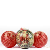 Christmas bauble in front of others red balls. Square format. Christmas bauble with a drawing of Santa Claus in front of others red balls. White space on top Stock Images