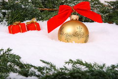 Christmas bauble with gift box Stock Photography