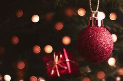 Christmas Bauble and Gift on Tree with Bokeh Lights in Retro Sty Stock Image
