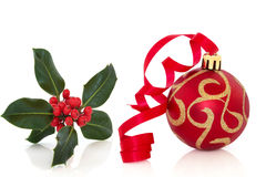 Christmas Bauble and Holly Royalty Free Stock Image