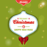 Christmas bauble label on green background Stock Photo
