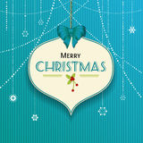 Christmas bauble lable on blue texture. Christmas Bauble label on a Blue texture Background Stock Photos