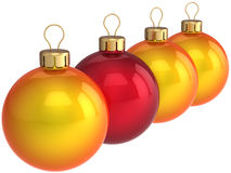 Christmas bauble leadership (Hi-Res). Four colorful (three orange and one red) shining Christmas balls. New Year Leadership concept. This is a detailed 3D render Royalty Free Stock Photo