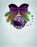 Christmas bauble with lilac bow Stock Photography