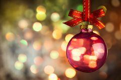 Christmas  bauble over Beautiful magic bokeh background. Horizontal Stock Image
