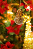 Christmas bauble over golden lights tree Royalty Free Stock Images