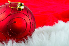 Christmas bauble over red Royalty Free Stock Images